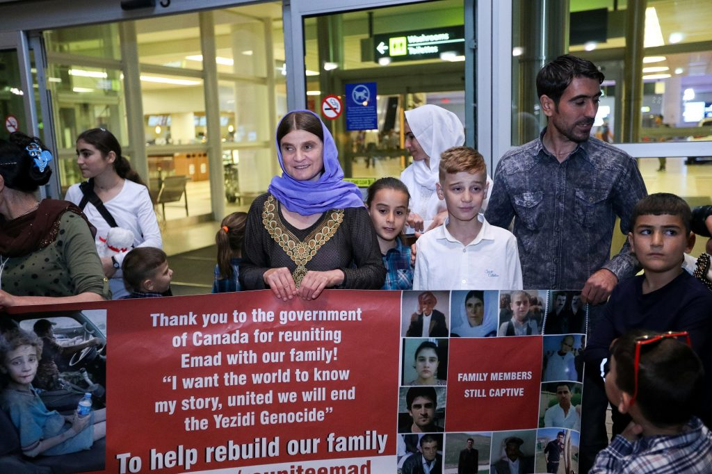 Imad Mishko Tammo, twelve-year-old Yazidi boy, who was separated from his family after being captured by Islamic State militants in Iraq, is reunited with his mother and siblings on arrival in Winnipeg, Manitoba, Canada August 17, 2017. REUTERS/Kelly Morton - RC1A86DB6160